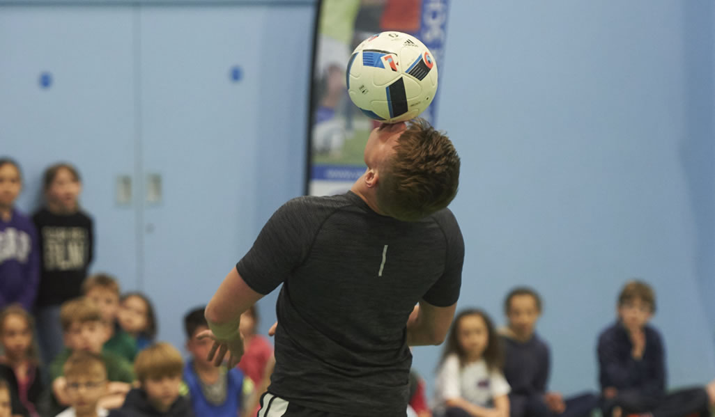 Performing Freestyle Football Tricks For Children